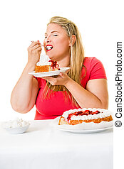 Obese woman eating strawberry cream cakes
