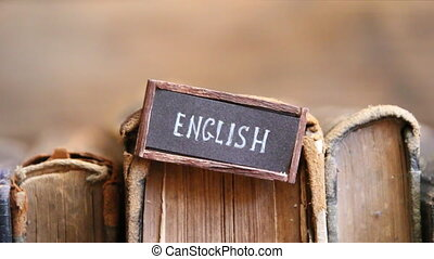 English tag and books - English tag and vintage books on a...