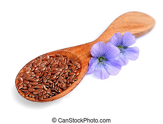 Flax seeds with flowers close up .