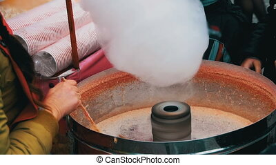 Making of Cotton Candy in Slow Motion 96 fps. Working woman...