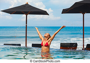 Woman swim in ocean beach infinity pool - Happy woman have...