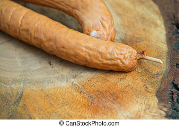 Close up of sausage on wood background