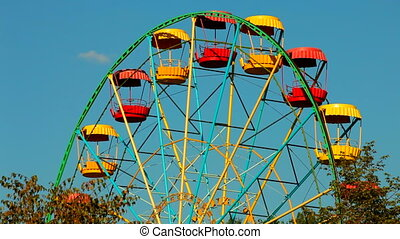 Ferris wheel in an amusement park on a background of blue...