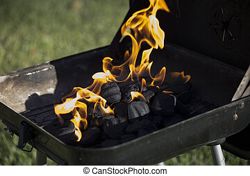 Charcoal flaming - Flaming charcoal in barbecue pit