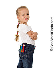 Little proud girl with pencils in her pocket ready for...