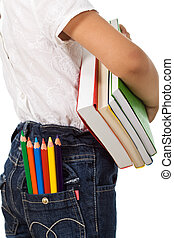 Back to school - kid with colorful books and pencils
