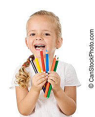 Happy little girl with colored pencils