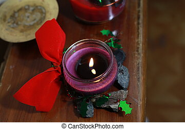 Purple Candle with Christmas Decorations - Purple candle and...