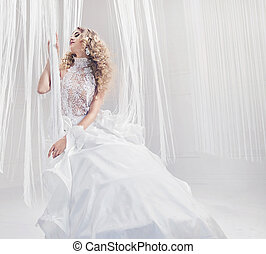 Pretty young woman wearing elegant gown