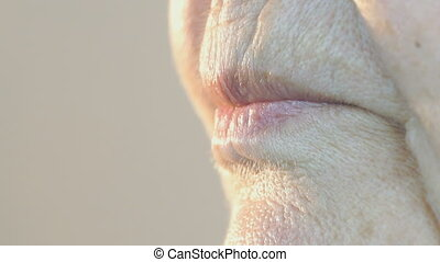 Mouth of elderly woman with false teeth. Close up