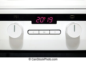 Control panel of modern white kitchen electric stove -...