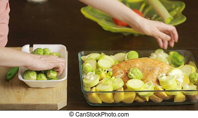 Cooking chicken with vegetables in a glass