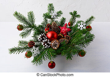 Christmas table centerpiece with red balls and rustic ornaments