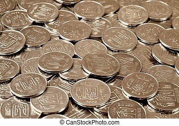 A pile of coins Ukrainian - A large pile of coins from a...