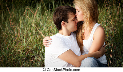 young couple embrace