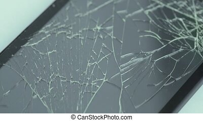 Broken cellular phone screen - View of broken cellular phone...