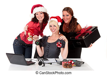 Christmas in the office - Three attractive businesswomen...