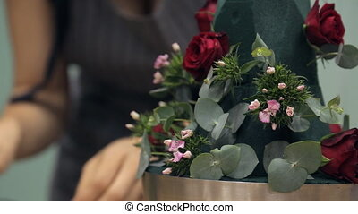 Florist is a bouquet of roses, pine needles, leaves and...