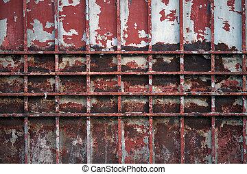 Abstract vintage steel door eroding rust.