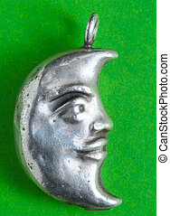 Half Moon Silver Jewel over a Colored Background