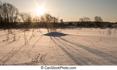 Shadows on the snow on sunset. Zoom. Time Lapse, Russia
