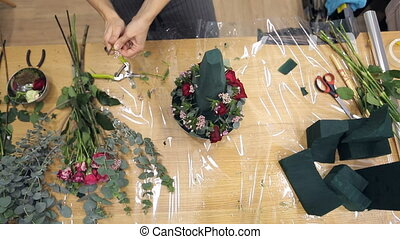 Top view video of a florist creating a fresh flower...