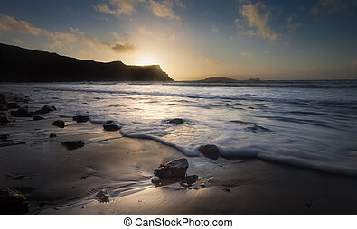 Sunset at Rhossili Bay and Worms Head on the Gower...