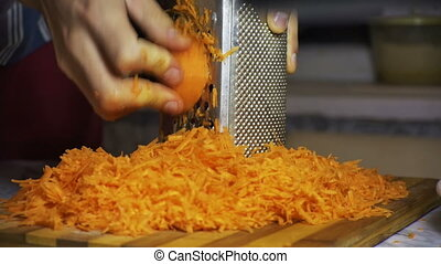 Carrots on a Grater Rubbed on the Home Kitchen - Carrots on...