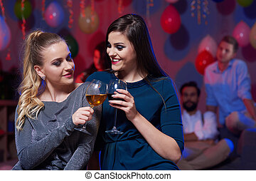 Women holding drinking glass during dance