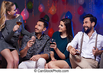 Enthusiastic friends cheering at party