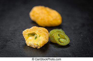 Cheese Nuggets (with Chilis) (selective focus, close-up...