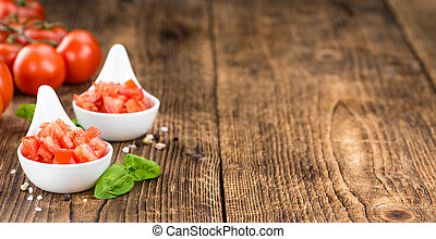 Cutted Tomatoes on vintage wooden background - Tomatoes...