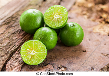 Green lemon - Lemon and Half of lemon citrus fruit with...