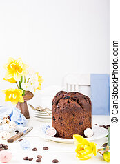 Easter orthodox sweet chocolate bread and colorful quail...