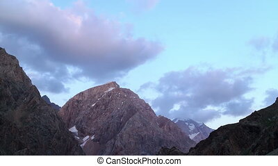 Clouds over mountains. Zoom. Time Lapse. Pamir, Tajikistan ....