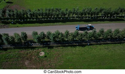 Aerial view a tractor driving on road - Aerial view tractor...