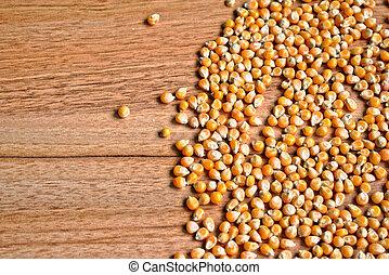 Popcorn Kernels - Popcorn kernels on a wooden table