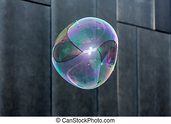 The transparent, iridescent soap bubbles on black background...