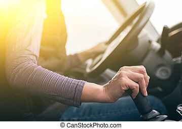 hands of a driver on gearbox - woman hands of a driver on...