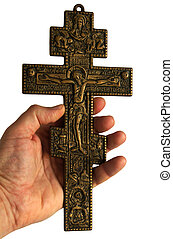 Cross with crucified Jesus Christ - Human hands holding...