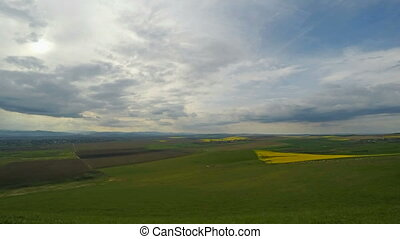 Rural scene with rape field, time-lapse