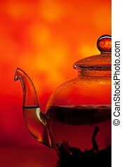 Teapot on a bright background - Teapot from a glass on a...