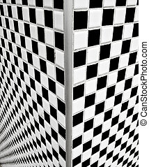 Black and white checkerboard tiles - Corner view of black...