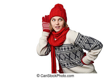 Woman in winter warm clothing listening gossip - Young woman...