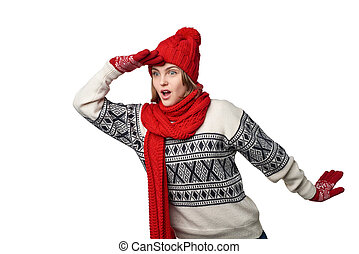 Surprised winter woman looking forward with palm on...