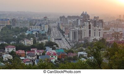 General view of the Avenue Al-Farabi. Sunset. Almaty,...