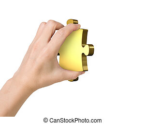 Hand holding one golden puzzle piece, isolated on white.