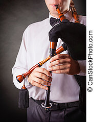 Spanish bagpipes - Close-up of a musician playing the...