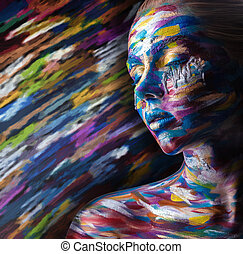 Body art - Beautiful woman with colorful makeup and body art...