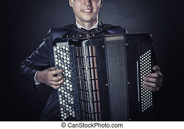 Accordion - Closeup of musician playing the accordion on a...